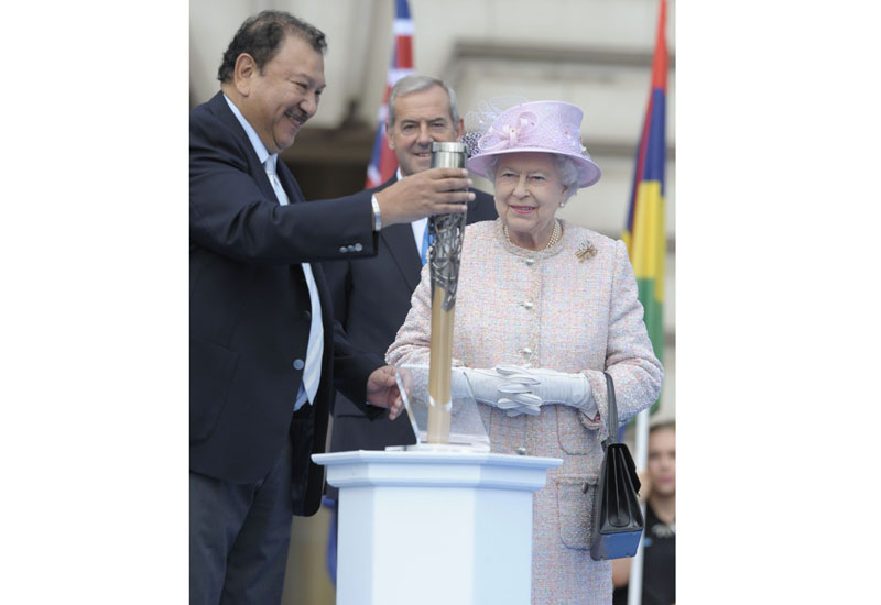 HM-The-Queen-with-the-Commonwealth-games-baton.jpg