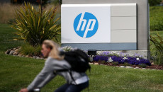 PALO ALTO, CA - MAY 23:  A cyclist rides by a sign outside of the Hewlett-Packard headquarters on May 23, 2014 in Palo Alto, California.  HP announced on Thursday that it plans to lay off an additional 11,000 to 16,000 employees over its previously scheduled mass layoffs of 34,000.  (Photo by Justin Sullivan/Getty Images)