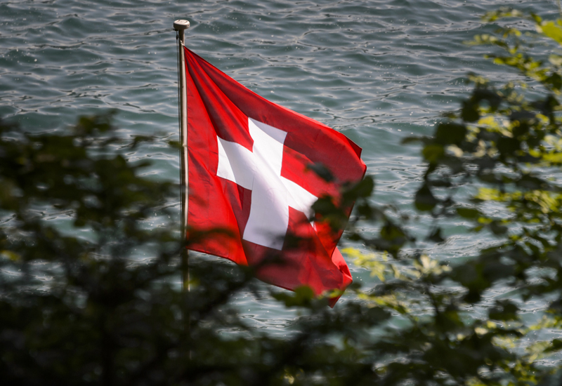 A Swiss flag float on June 5, 2015 above Lake Lucerne in Rutli meadow considered as the birthplace of Switzerland. According to the legend, it was in the Rutli Meadow in 1291 where representatives of the original Swiss cantons, Schwyz, Uri and Unterwalden, took an oath to protect one another from the great threat of the era, the Austrians. Now, each August 1st (the reputed date of the Rutli oath) Switzerland celebrates their independence and courageous beginnings.    AFP PHOTO / FABRICE COFFRINI        (Photo credit should read FABRICE COFFRINI/AFP/Getty Images)
