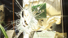 """A smashed showcase window is pictured on August 16, 2013 at the """"Palais de la Mediterranee"""" hotel in Nice, French Riviera, after two armed men robbed luxury watches permanently displayed in two showcases of the hotel lobby.      AFP PHOTO / JEAN CHRISTOPHE MAGNENET        (Photo credit should read JEAN CHRISTOPHE MAGNENET/AFP/Getty Images)"""