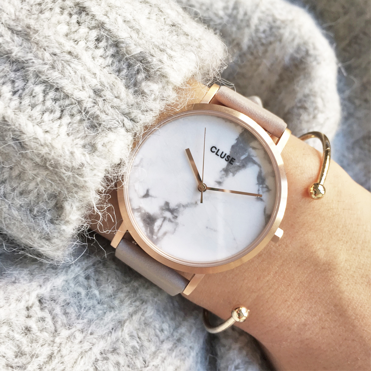 La Roche in rose gold with white marble face.