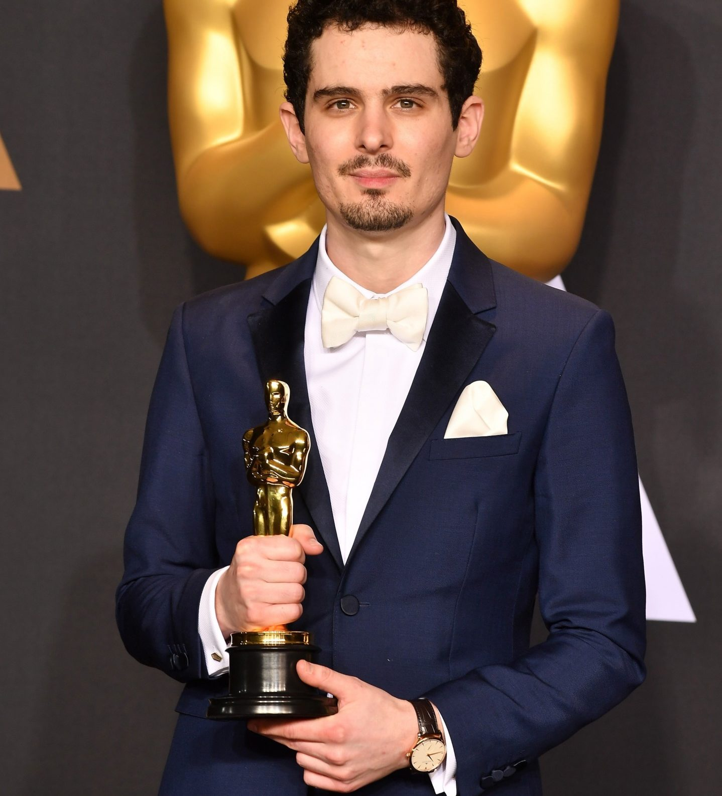 HOLLYWOOD, CA - FEBRUARY 26:  Director Damien Chazelle, winner of the Best Director award for 'La La Land,' poses in the press room during the 89th Annual Academy Awards at Hollywood & Highland Center on February 26, 2017 in Hollywood, California.  (Photo by Jeff Kravitz/FilmMagic)