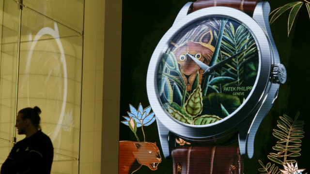 A watch is displayed on a giant screen at the stand of Swiss watchmaker Patek Philippe during the press day on the eve of the opening of the Baselworld watch and jewellery show on March 22, 2017 in Basel in Switzerland. The world's biggest watch fair will open in Switzerland this week, even as slumping exports of luxury Swiss timepieces appear to dash hopes of a market rebound. / AFP PHOTO / Fabrice COFFRINI        (Photo credit should read FABRICE COFFRINI/AFP/Getty Images)