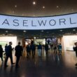 Visitors enter during the press day of Baselworld watch and jewellery show on March 22, 2017 in Basel. The world's biggest watch fair will open in Switzerland this week, even as slumping exports of luxury Swiss timepieces appear to dash hopes of a market rebound. / AFP PHOTO / Fabrice COFFRINI        (Photo credit should read FABRICE COFFRINI/AFP/Getty Images)