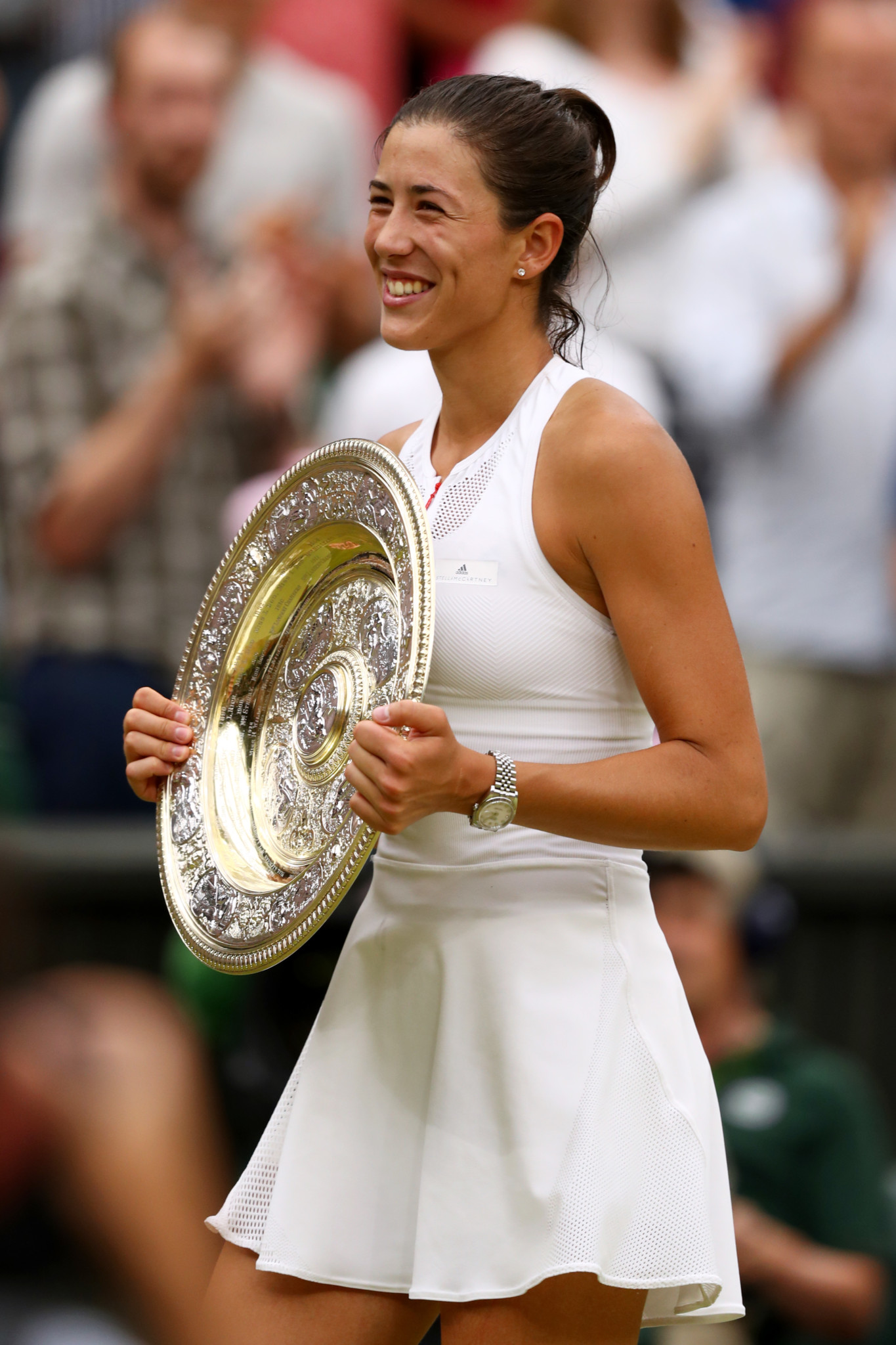 Garbine Muguruza of Spain celebrates victory with the trophy after the Ladies Singles final against Venus Williams.  (Photo by Michael Steele/Getty Images)
