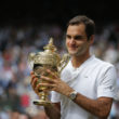 Roger Federer of Switzerland celebrates victory with the trophy after the Gentlemen's Singles final against  Marin Cilic of Croatia on day thirteen of the Wimbledon Lawn Tennis Championships at the All England Lawn Tennis and Croquet Club at Wimbledon on July 16, 2017 in London, England.  (Photo by Daniel Leal-Olivas - Pool/Getty Images)