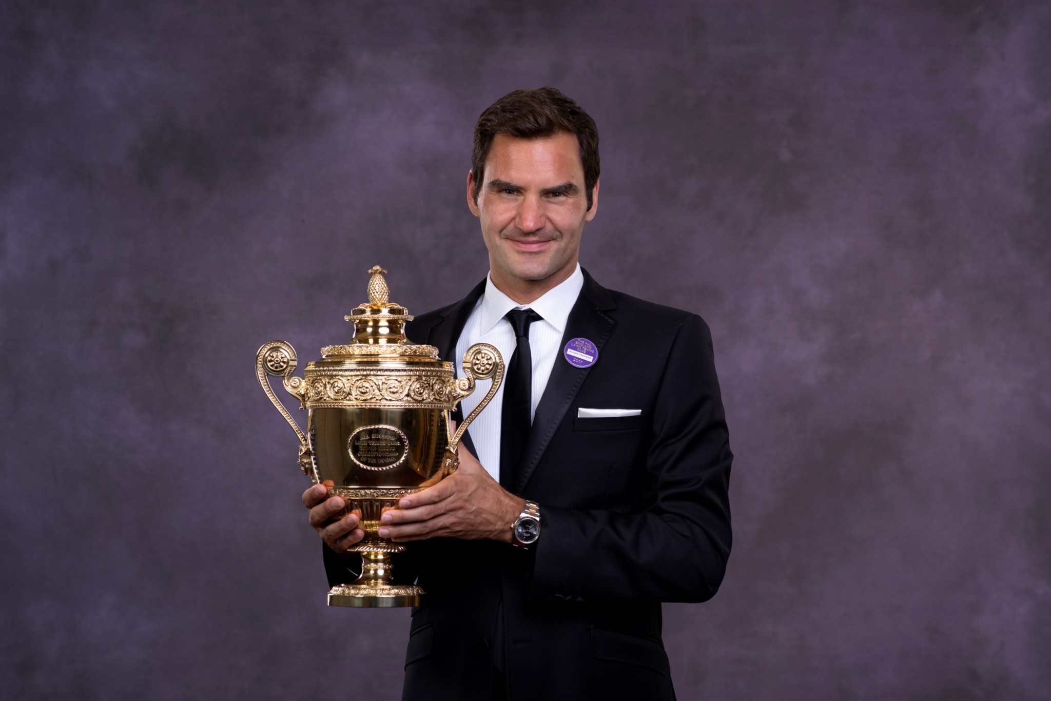 Roger Federer poses with the trophy at the Wimbledon Winners Dinner. (Photo by AELTC - Pool / Getty Images)