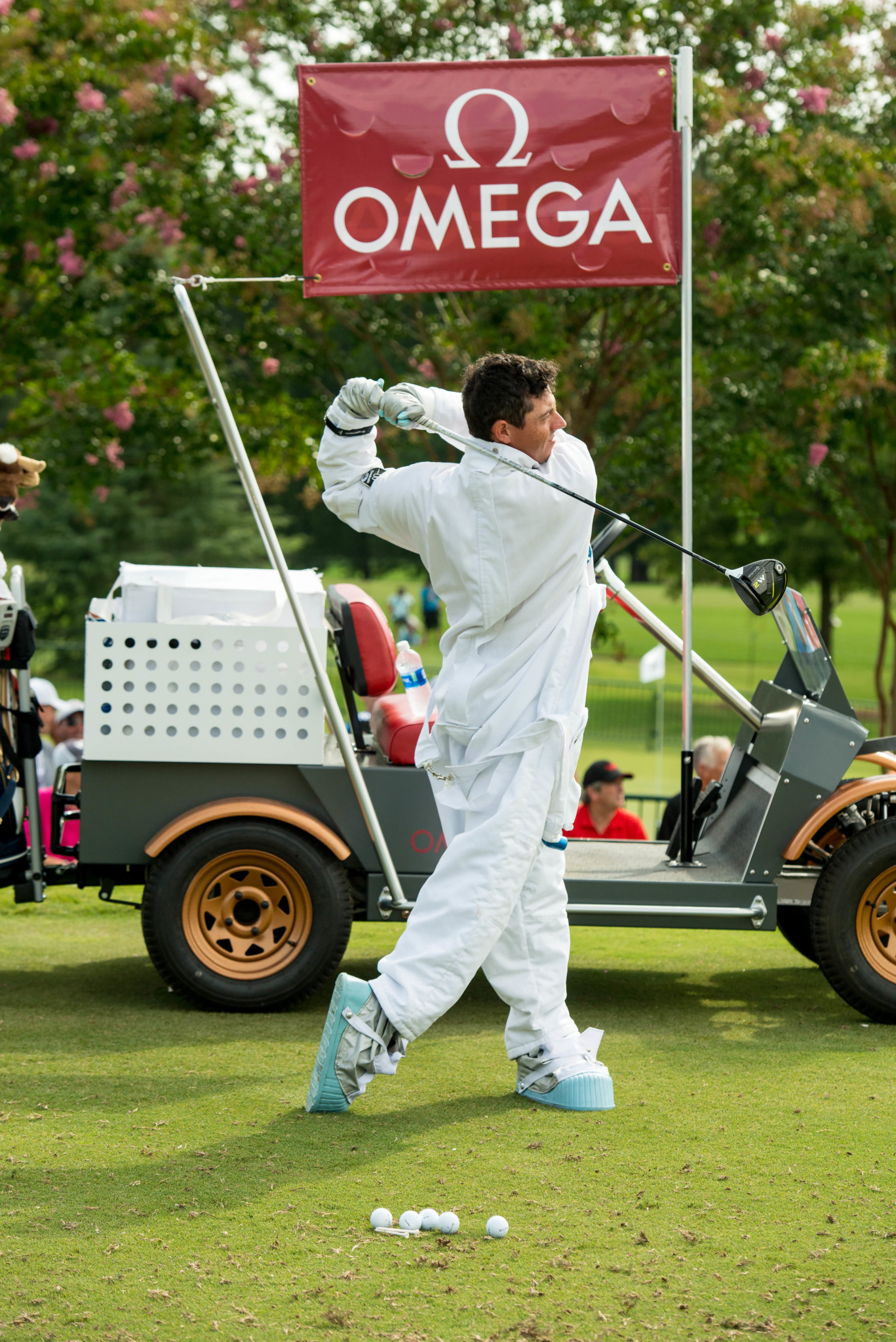 Rory McIlroy Hits Drive in Astronaut Uniform - OMEGA