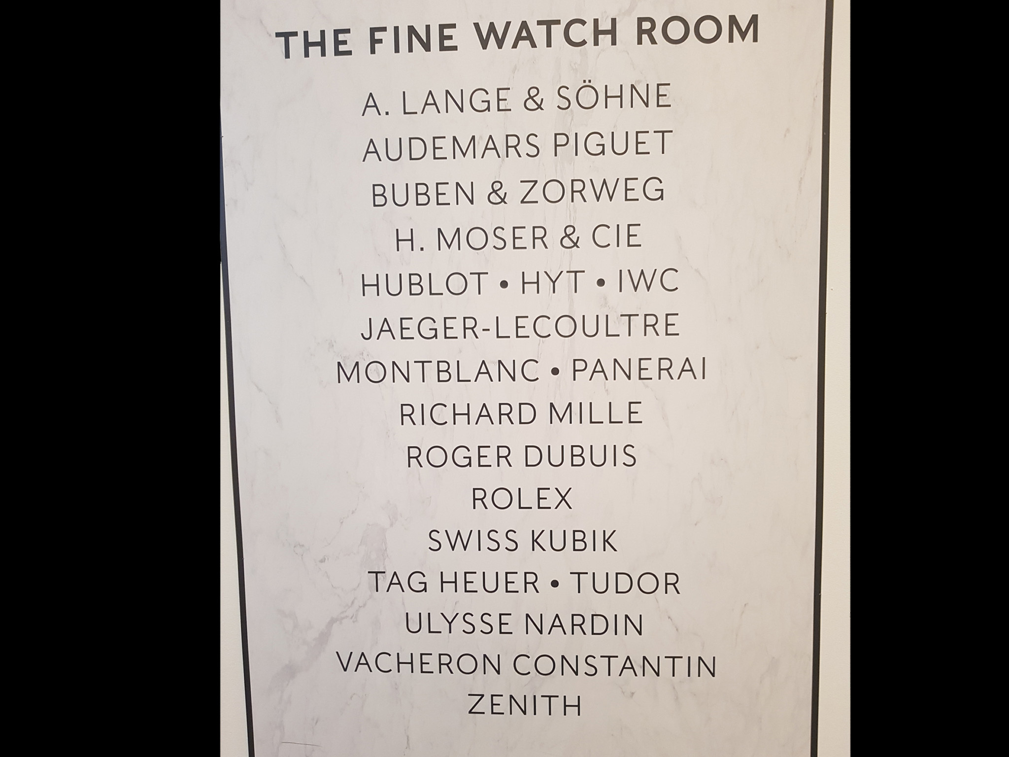 The Harrods Fine Watch Room is currently undergoing major refurbishment work, with hoardings displaying a list of watch brands.