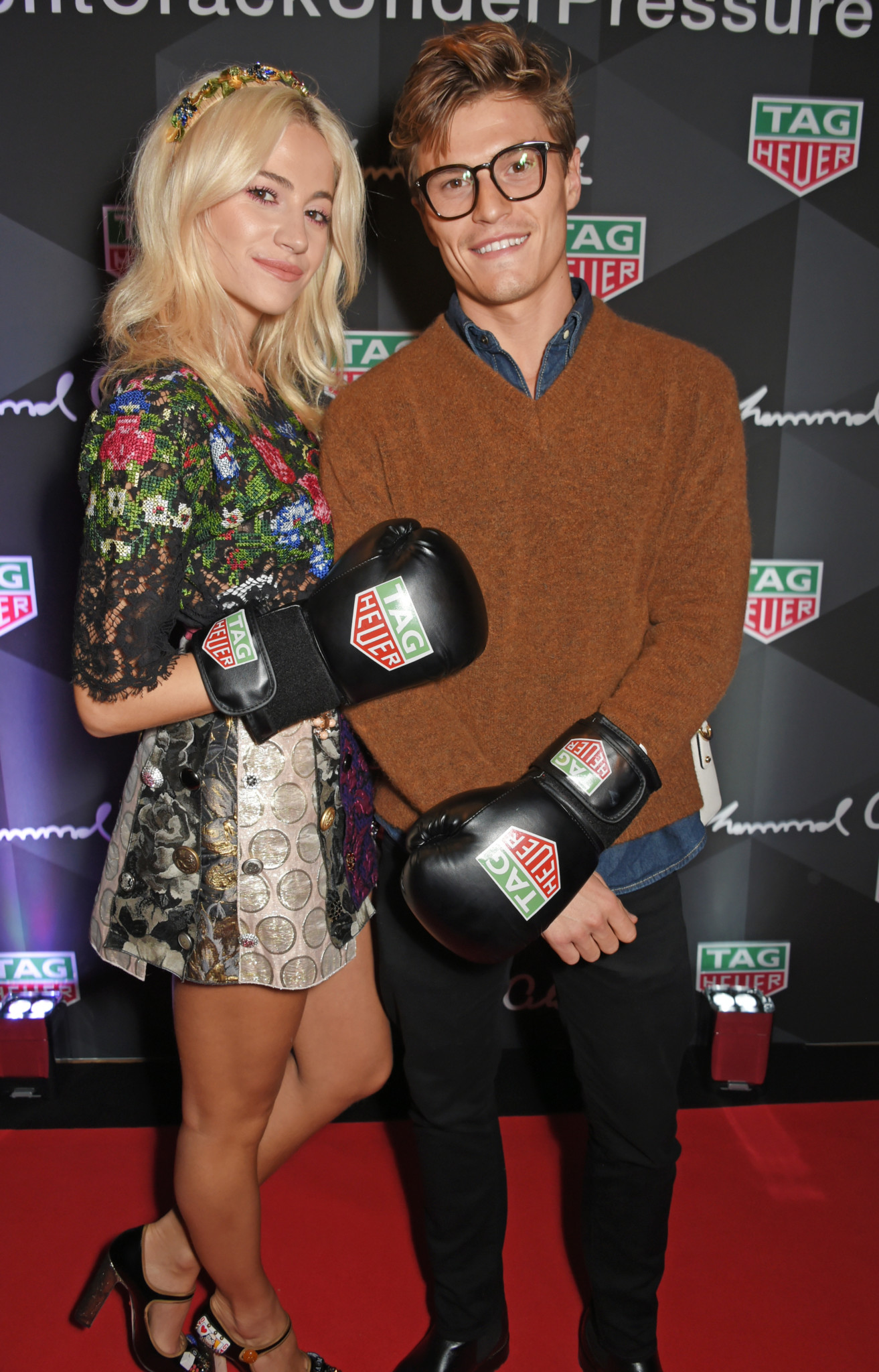 LONDON, ENGLAND - OCTOBER 10:  Pixie Lott (L) and Oliver Cheshire attend the launch of the TAG Heuer Muhammad Ali Limited Edition Timepieces at BXR Gym on October 10, 2017 in London, England.  Pic Credit: Dave Benett
