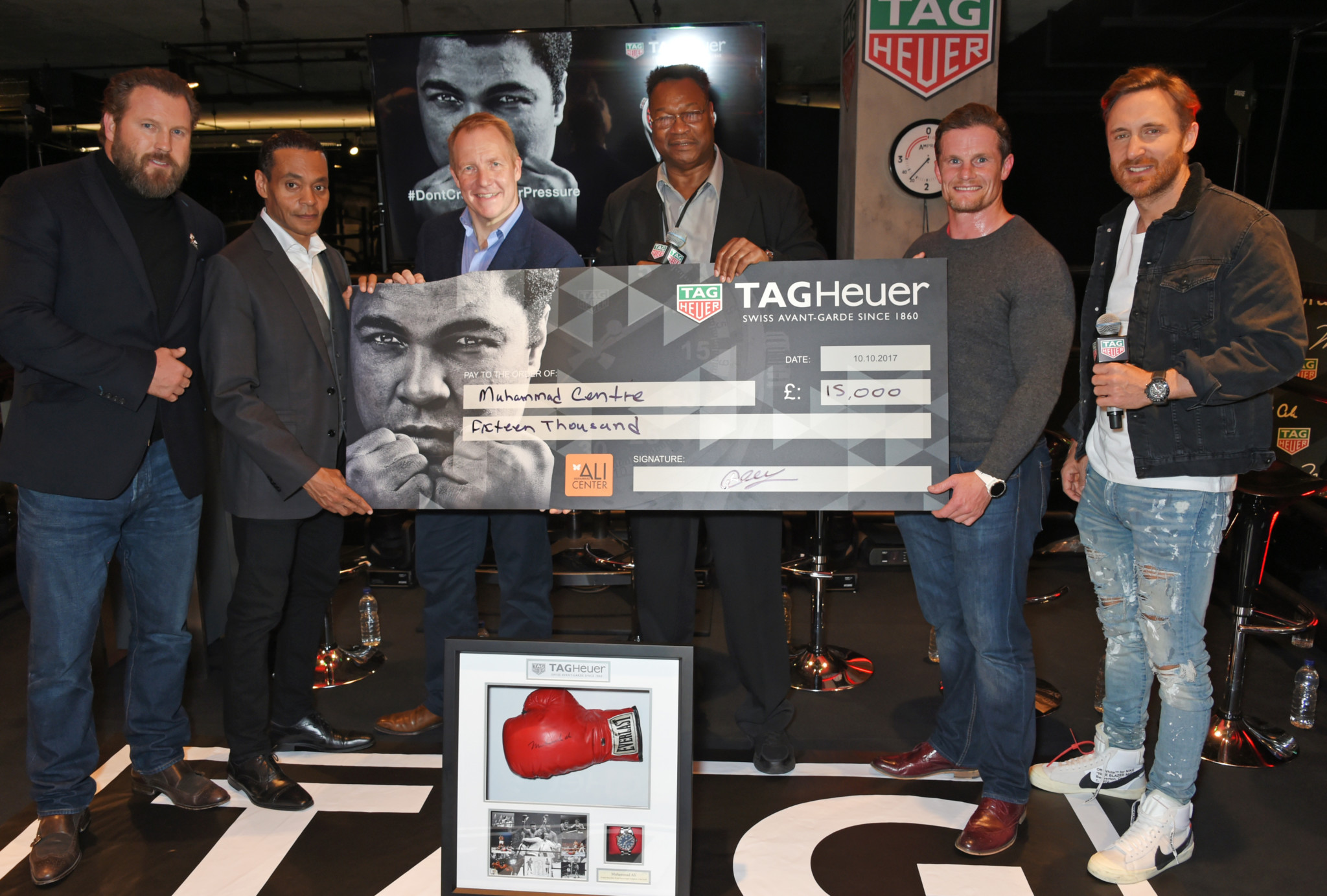 (L to R) Scott Welch, Chairman of the World Boxing Council, Donald E. Lassere, CEO of the Muhammad Ali Center, Larry Holmes, guest and David Guetta attend the launch of the TAG Heuer Muhammad Ali Limited Edition Timepieces.