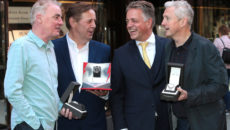 "Craig Leach, Brand Director of RAYMOND WEIL (Third from Left) presents  Dave Fanning  with his  Raymond Weil  Limited Edition  Maestro 'The Beatles ""Abbey Road"" watch,Louis Walsh with his  Raymond Weil  Limited Edition maestro watch which pays tribute to legendary musician Buddy Holly and  Ian Dempsey with his  Raymond Weil  Limited Edition freelancer ""David Bowie"" watch  featuring the lightning bolt that was painted across his face which first appeared on the cover of the Aladdin Sane album in 1973 at Weirs Grafton Street ,Dublin ,  Picture Brian McEvoy No Repro fee for one use   RAYMOND WEIL CELEBRATES THE GENIUS OF THREE LEGENDARY MUSIC REPERTOIRES –  DAVID BOWIE, THE BEATLES & BUDDY HOLLY WITH THREE ICONS OF THE IRISH MUSIC INDUSTRY LOUIS WALSH, IAN DEMPSEY AND DAVE FANNING     Renowned Swiss luxury watchmaker RAYMOND WEIL is paying homage to the holy trinity of music icons David Bowie, The Beatles and Buddy Holly with the release of three exclusive limited edition timepieces.  To mark the launch of these signature pieces, Craig Leach, Brand Director of RAYMOND WEIL presented three Icons of the Irish music industry with their Hero's watches - Louis Walsh with Buddy Holly; Ian Dempsey with David Bowie and Dave Fanning with The Beatles, in Weir & Sons, Grafton Street, Dublin.     An impresario of the contemporary music scene, Louis's roots are in the guitar rifts of Buddy Holly, globally recognised as the pioneer of Rock 'n'Roll. RAYMOND WEIL in collaboration with his wife Maria Elena Holly, has designed the Limited Edition maestro which pays tribute to legendary musician Buddy Holly.     A lifelong fan of David Bowie, Ian Dempsey proved his devotion to him when as part of last year's Today FM's 'Dare To Care' campaign, he got a black star tattooed on his arm as a tribute to David Bowie whose last album was titled Black Star.RAYMOND WEIL presented Ian with the freelancer ""David Bowie"" featuring the lightning bolt that was painted across his face which first appear"