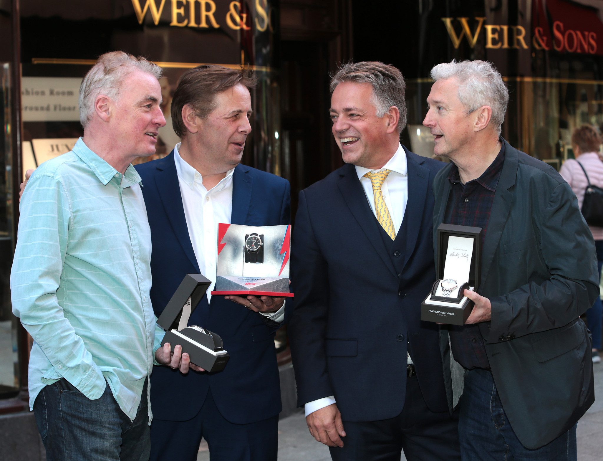 """Craig Leach, Brand Director of RAYMOND WEIL (Third from Left) presents  Dave Fanning  with his  Raymond Weil  Limited Edition  Maestro 'The Beatles """"Abbey Road"""" watch,Louis Walsh with his  Raymond Weil  Limited Edition maestro watch which pays tribute to legendary musician Buddy Holly and  Ian Dempsey with his  Raymond Weil  Limited Edition freelancer """"David Bowie"""" watch  featuring the lightning bolt that was painted across his face which first appeared on the cover of the Aladdin Sane album in 1973 at Weirs Grafton Street ,Dublin ,  Picture Brian McEvoy No Repro fee for one use   RAYMOND WEIL CELEBRATES THE GENIUS OF THREE LEGENDARY MUSIC REPERTOIRES –  DAVID BOWIE, THE BEATLES & BUDDY HOLLY WITH THREE ICONS OF THE IRISH MUSIC INDUSTRY LOUIS WALSH, IAN DEMPSEY AND DAVE FANNING     Renowned Swiss luxury watchmaker RAYMOND WEIL is paying homage to the holy trinity of music icons David Bowie, The Beatles and Buddy Holly with the release of three exclusive limited edition timepieces.  To mark the launch of these signature pieces, Craig Leach, Brand Director of RAYMOND WEIL presented three Icons of the Irish music industry with their Hero's watches - Louis Walsh with Buddy Holly; Ian Dempsey with David Bowie and Dave Fanning with The Beatles, in Weir & Sons, Grafton Street, Dublin.     An impresario of the contemporary music scene, Louis's roots are in the guitar rifts of Buddy Holly, globally recognised as the pioneer of Rock 'n'Roll. RAYMOND WEIL in collaboration with his wife Maria Elena Holly, has designed the Limited Edition maestro which pays tribute to legendary musician Buddy Holly.     A lifelong fan of David Bowie, Ian Dempsey proved his devotion to him when as part of last year's Today FM's 'Dare To Care' campaign, he got a black star tattooed on his arm as a tribute to David Bowie whose last album was titled Black Star.RAYMOND WEIL presented Ian with the freelancer """"David Bowie"""" featuring the lightning bolt that was painted across his face which first appear"""
