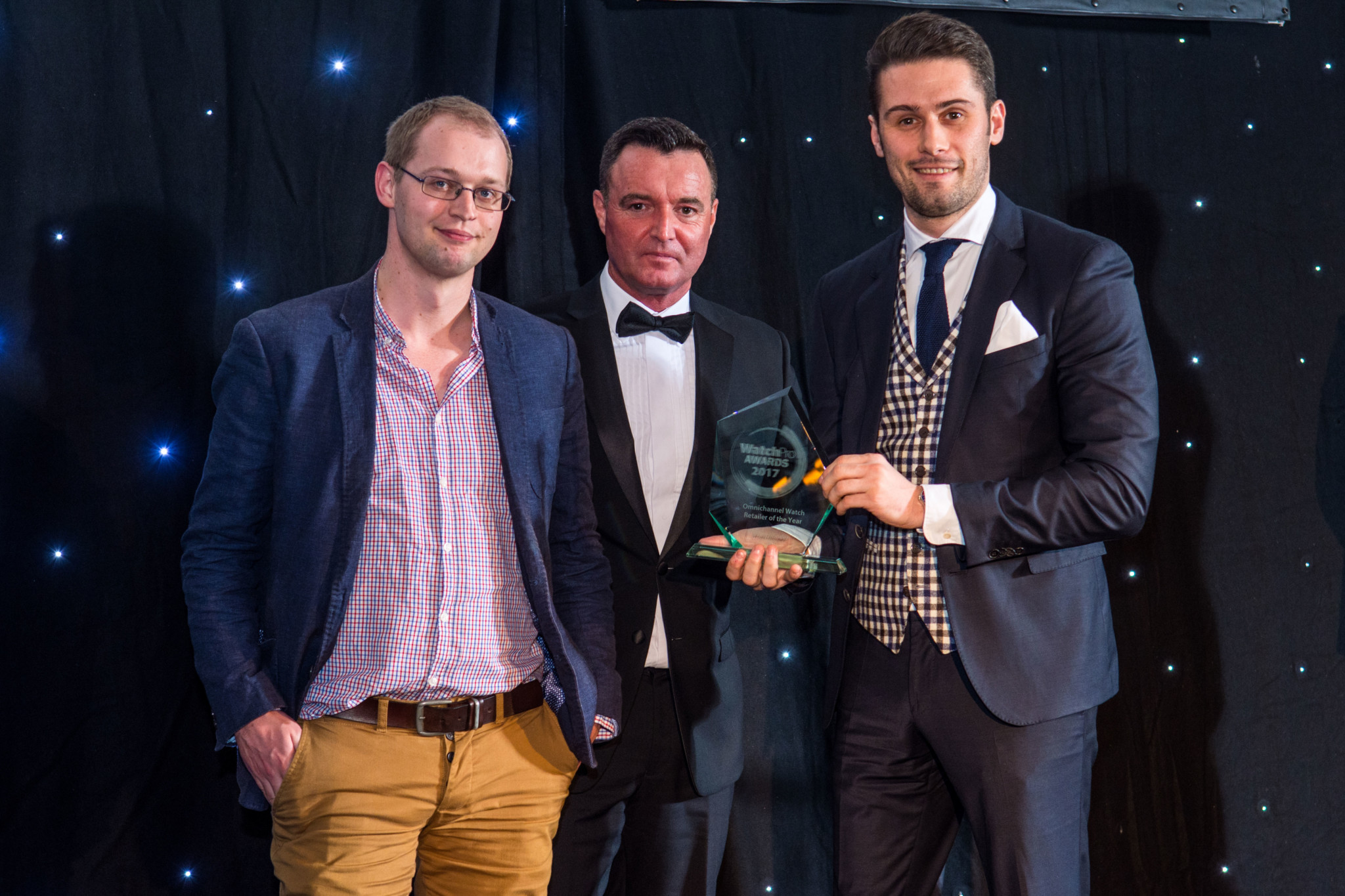 Watchfinder's Jude Harrison, head of marketing and Sam Beer, head of purchasing collect the award for Omnichannel Retailer of the Year from Colin Lee, managing director of Mondaine's UK distributor, Burton McCall (centre).