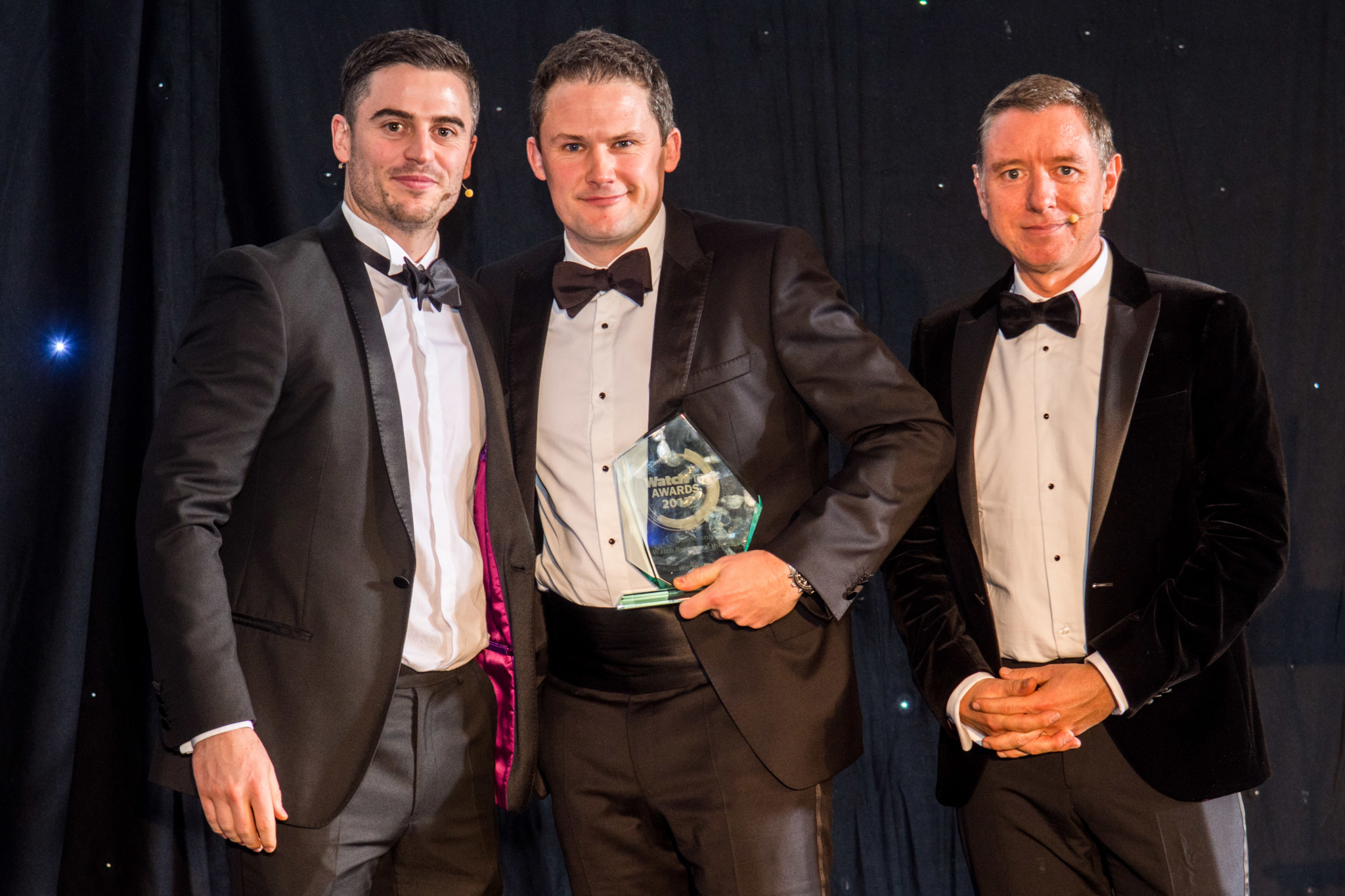 Alex Fisher, CEO of Watchshop, collects the award from WatchPro's Daniel Malins and Rob Corder.