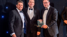 Redd Retail Group director Karl Turnbull presents the Marketing and Merchandising Team of the Year Award to Breitling's Chris Park, head of UK sales, and  Gavin Murphy, UK managing director.