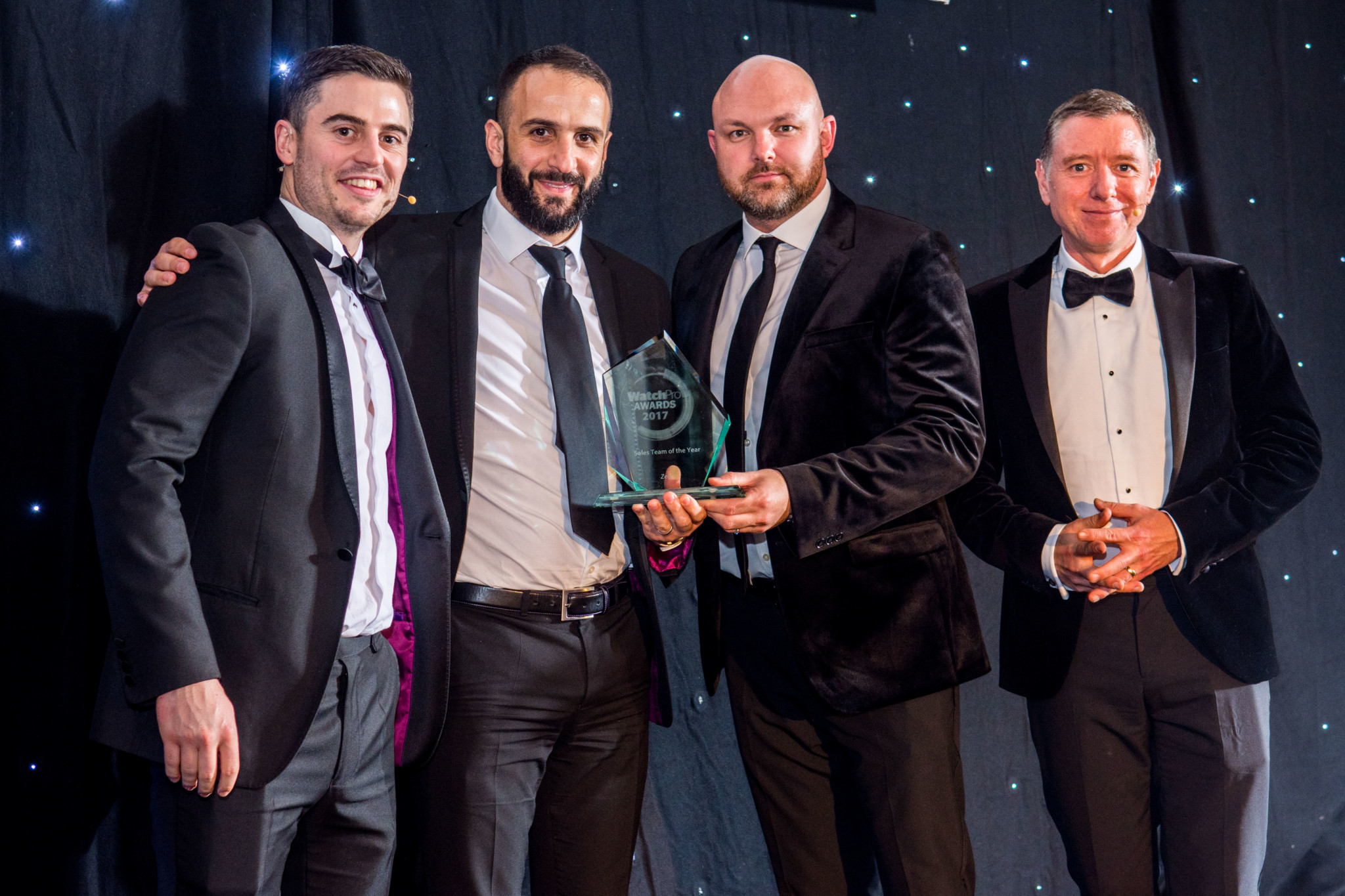 WatchPro publisher Daniel Malins presents the award to Zeon's Javier Guerra, head of sales; and Simon Gilham, managing director.
