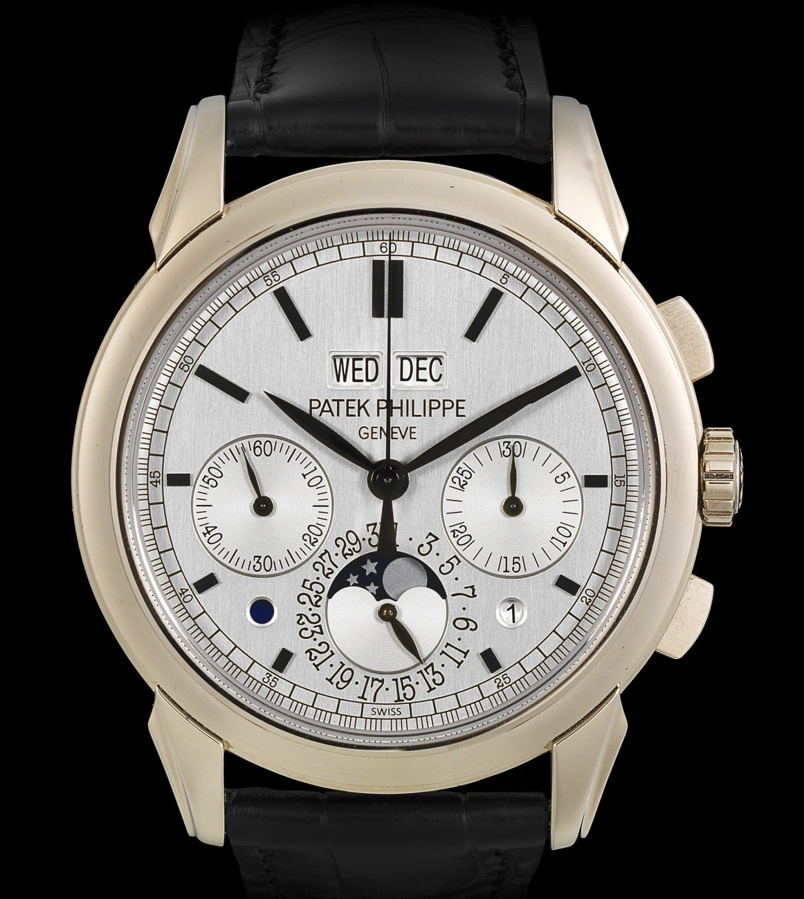 Patek Philippe. A fine 18K white gold manual wind perpetual calendar chronograph wristwatch with moon phase