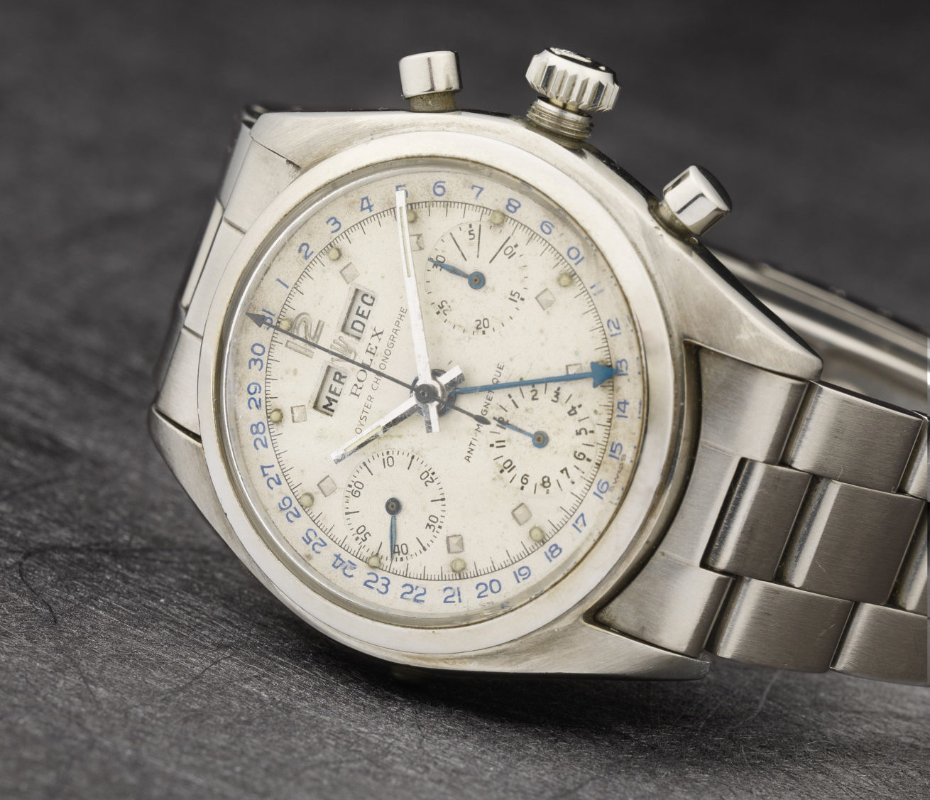 Rolex. A rare stainless steel manual wind triple calendar chronograph bracelet watch