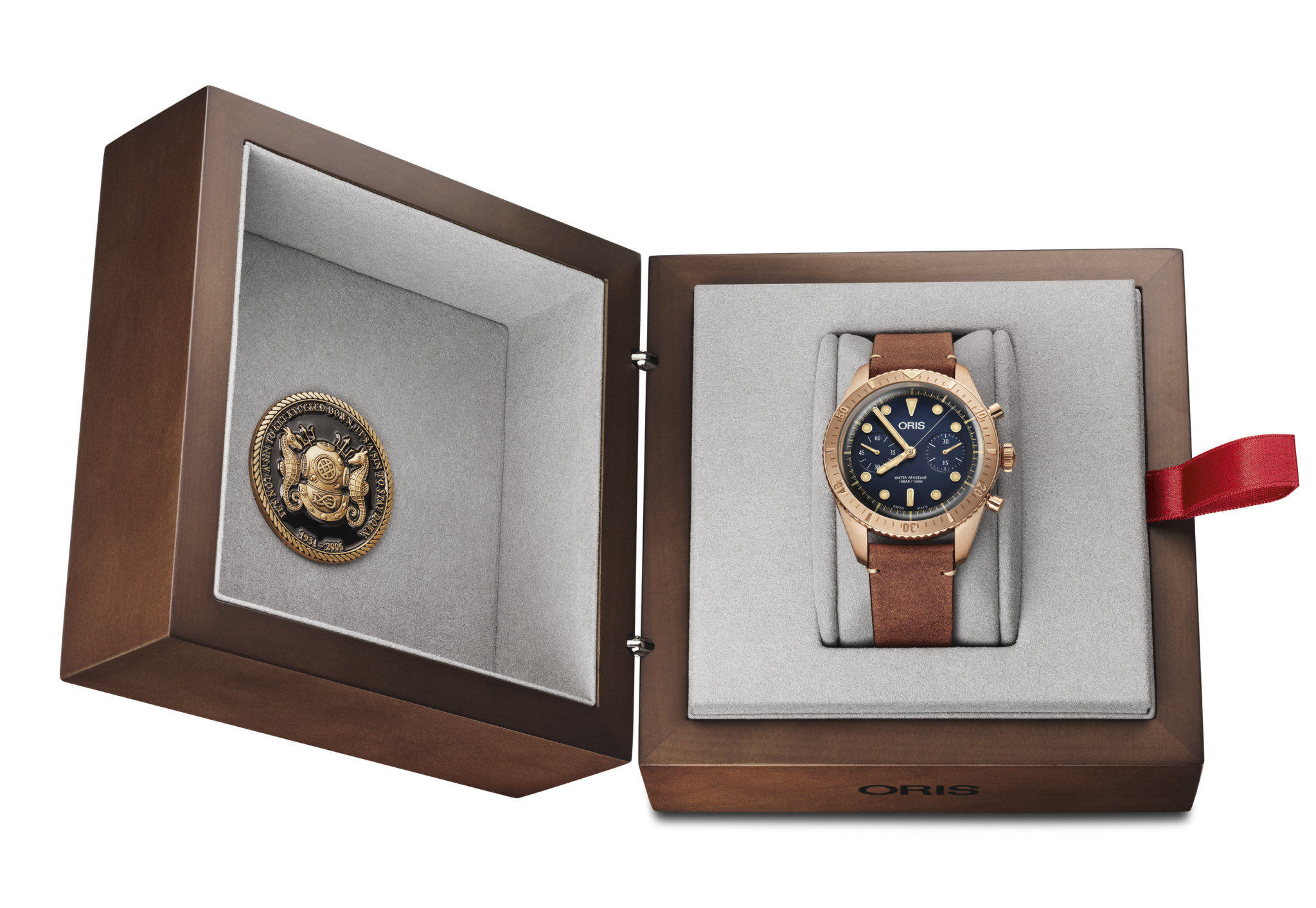 The watch comes in a wooden presentation box, complete with a coin issued by the Carl Brashear Foundation