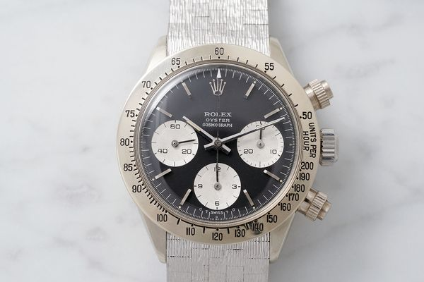 the-watch-is-fitted-with-a-sigma-dial-with-white-gold-indexes-which-are-consistent-with-the-case-met_s600x0_q80_noupscale